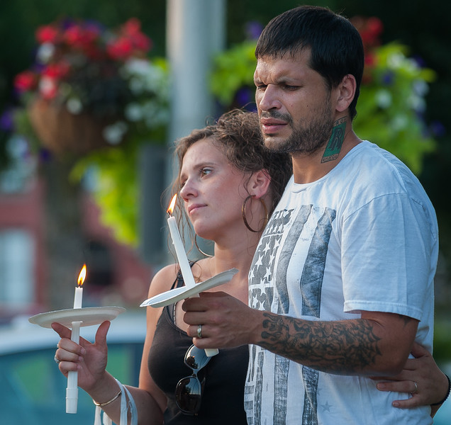 Family and friends of Leominster murder victim Corinna Santiago gather at a vigil for her in Monument Square. SENTINEL&ENTERPRISE/ Jim Marabello