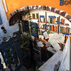 Sunken Bookstore  with shelves of Books Painted on Exterior Wall