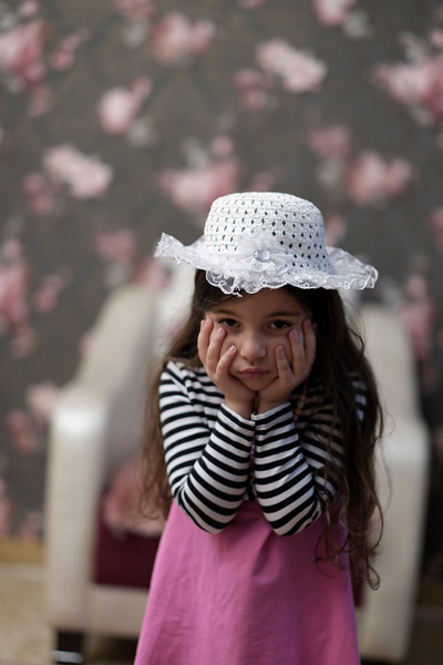 Small girl with white hat having fun indoor