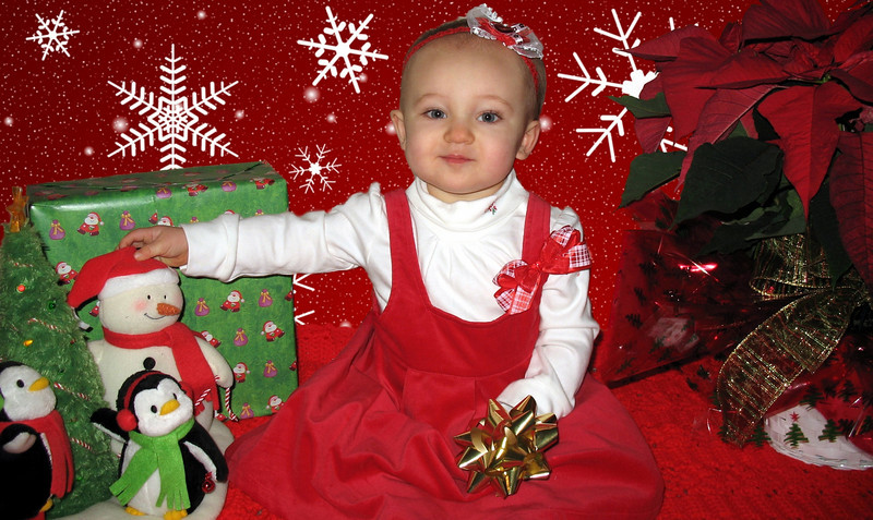 Christmas picture 2008... She was grinning at the dancing snowman and penguins.