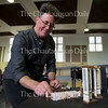 Stephen Osgood, the recently named the General and Artistic Director of the Chautauqua Opera Comany, poses for a portrait with a mini opera set in a practice room on June 20, 2016.