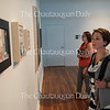 Leslie Calimeri and Amy Shake Strohl look at the 59th Chautauqua Annual Exhibition of Contemporary Art in Strohl Art Center on June 23, 2016.
