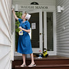 Sylvia Wengerd cleans the outside of Waugh Manor on Wednesday, June 12, 2019, before the 2019 season. SARAH YENESEL/STAFF PHOTOGRAPHER