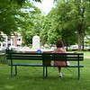 A woman sits in an empty Bestor Plaza on Wednesday, June 12, 2019, before the 2019 season. SARAH YENESEL/STAFF PHOTOGRAPHER