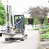 An excavator operator rides in the streets near the Amphitheater before the 2019 season on Wednesday, June 12, 2019. SARAH YENESEL/STAFF PHOTOGRAPHER