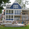 A house along South Lake Drive is swarmed with construction workers before the 2019 season on Wednesday, June 12, 2019. SARAH YENESEL/STAFF PHOTOGRAPHER