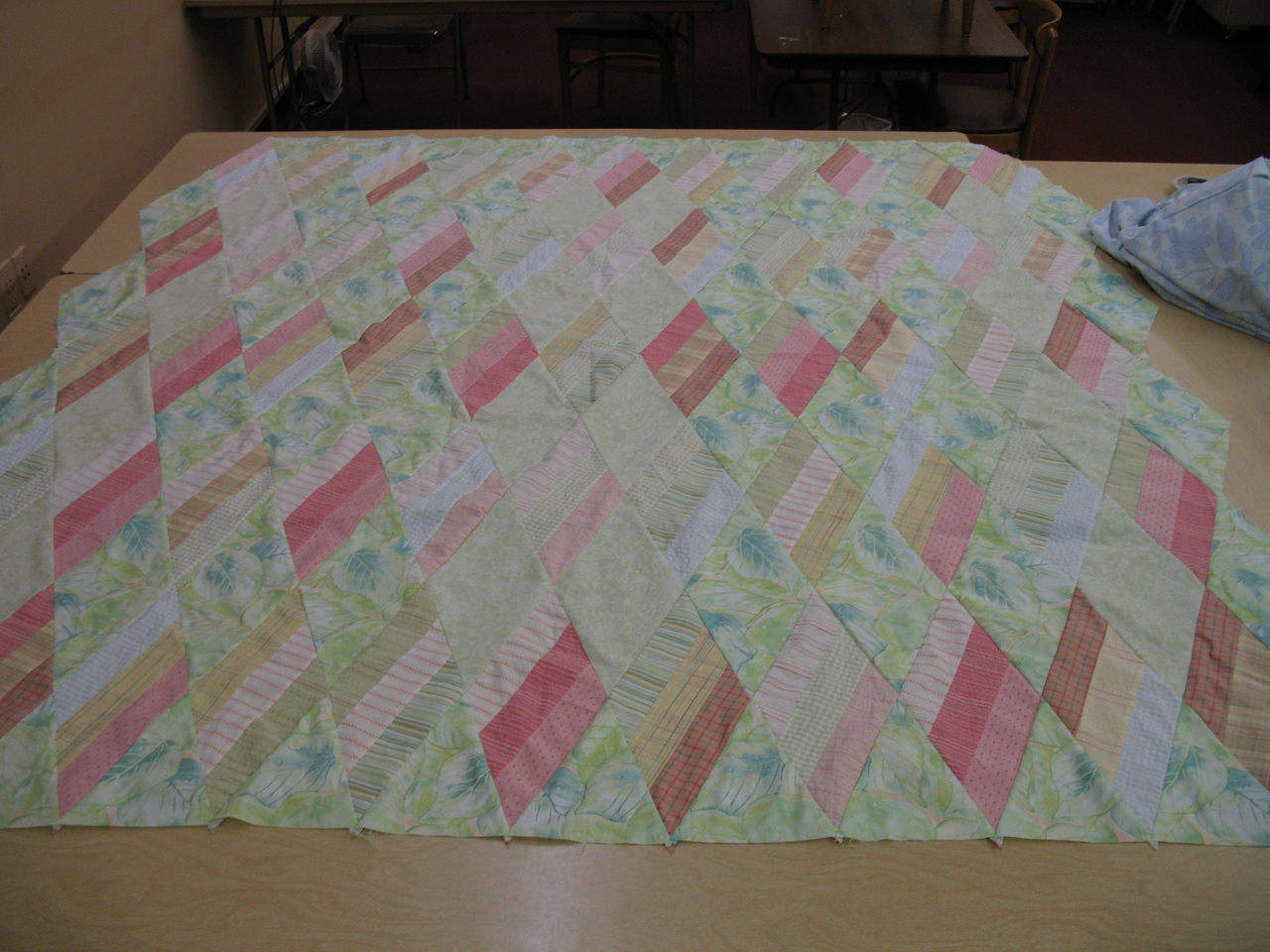 A quilt top I finished and ready to pin the layers together. It is laying on 3 eight foot tables. It is around a full size.