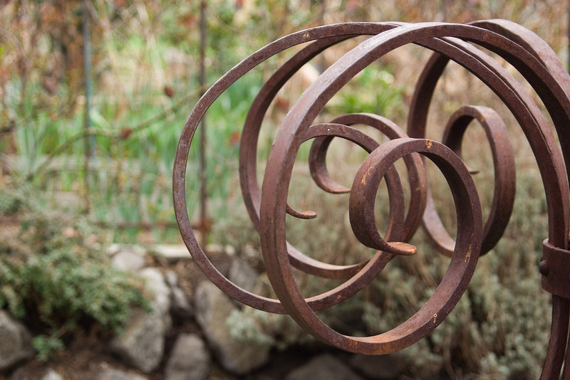 There is a beautiful metal sculpture at the entrance of the garden.  I couldn't resist this photo...swirls!