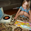 Eve listening to Rainbow Brite on mom's old record player.<br /> Oct 1, 2010