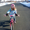 Eve loves her new bike so much she was actually willing to smile for the camera!<br /> 3/26/2011