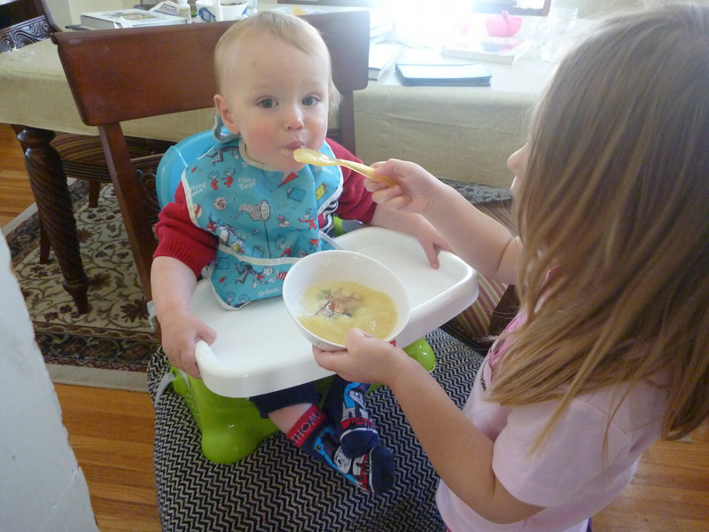 Big sister fed Graham two bowls of applesauce.<br /> 3/14/2011