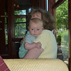 Grandma hiding behind Graham on the historic streetcar.<br /> 5/31/10