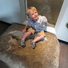 6/29/12<br /> Graham sitting in an Apatosaurus footprint at the Field Museum in Chicago