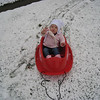Eve tries out her sled.