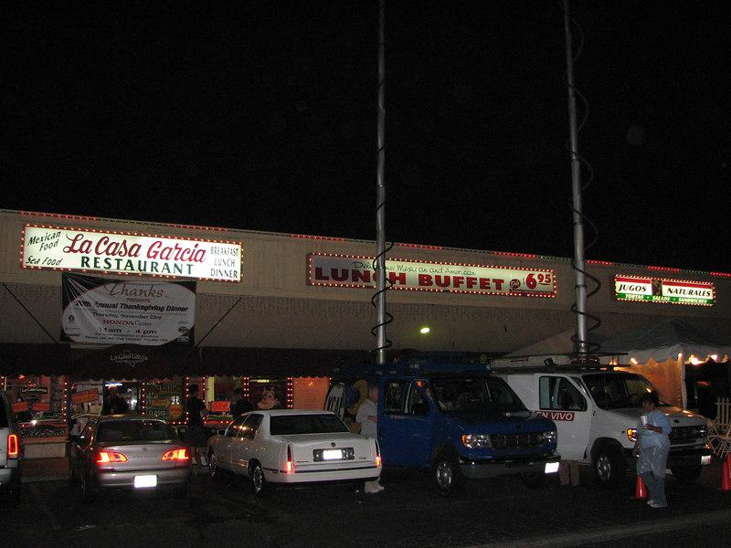 2006 11 22 Wed - La Casa Garcia store front with TV news vans