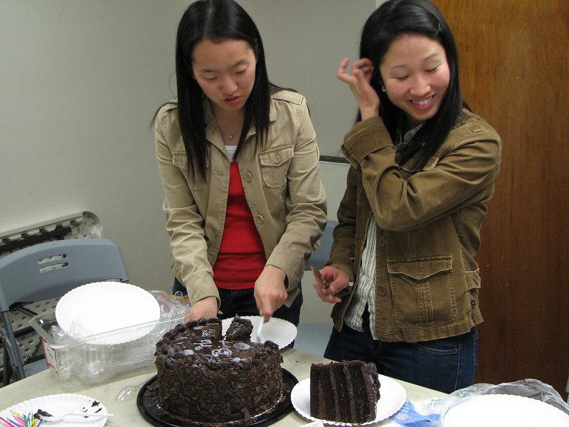 2007 03 09 Fri - Grace Park & Stella Lee cut the Costco bulk cake