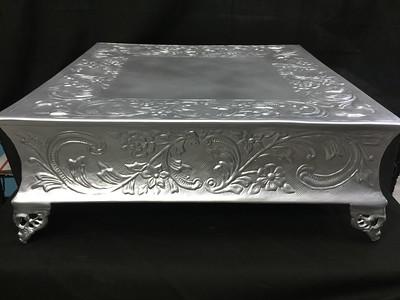"""18"""" Square Flat Silver Metal 6"""" tall. Rental $30"""