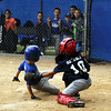 STAN HUDY - SHUDY@DIGITALFIRSTMEDIA.COM<br /> Julie & Co. Realty catcher Jack Gutch tags out a HT Lyons baserunner at the plate during the Saratoga Little League Minors AA championship game.