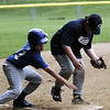 STAN HUDY - SHUDY@DIGITALFIRSTMEDIA.COM<br /> A HT Lyongs base runner looks to try to sneak around Julie & Co. Realty third baseman Jonny Kuhl late in the Saratoga Little League Minors AA championship game.