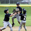 STAN HUDY - SHUDY@DIGITALFIRSTMEDIA.COM<br /> The Julie & Co. Realty squad celebrates its final out after defeating HT Lyons for the Saratoga American Little League AA championship.