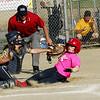STAN HUDY - SHUDY@DIGITALFIRSTMEDIA.COM<br /> Classie Lassies Boom catcher Joslyn Teal applies a tag high up on Saratoga Miss Thunder 10U base runner Olivia Tetreault who raced all the way around the base path after a successful bunt attempt in Sunday's championship game of the Miss Shen Slide into Summer tournament.