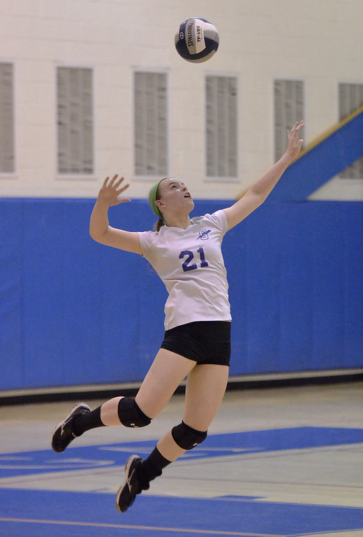 . Saratoga Springs sophomore Emmy Krum leaps up as part of her serve against Niskayuna Thursday afternoon.