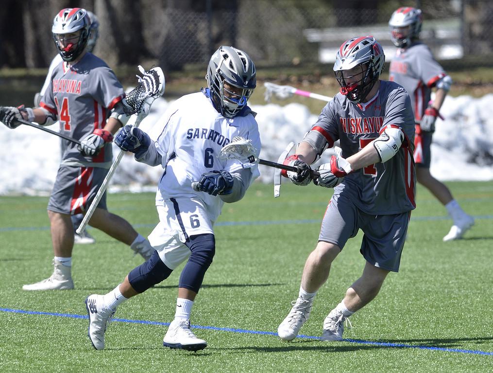 . STAN HUDY - SHUDY@DIGITALFIRSTMEDIA.COMNiskayuna middie Gabe Nish llooks to slow down Saratoga\'s Denzel Jenkins Thursday afternoon at Skidmore College\'s turf field.