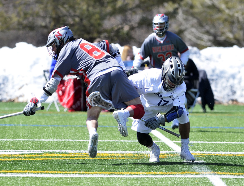 STAN HUDY - SHUDY@DIGITALFIRSTMEDIA.COM<br /> Saratoga's Jordan Mesquita partially upends Niskayuna's Eoghan Sweeney during a face-off Thursday afternoon at Skidmore College's turf field.