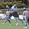 STAN HUDY - SHUDY@DIGITALFIRSTMEDIA.COM<br /> Niskayuna defense man Nick Fraterrigo upends a leaping Saratoga Springs Will Brooking as Silver Warrior teammate Jake Dominikowski (11) looks for the loose ball Thursday afternoon at Skidmore College's turf field.
