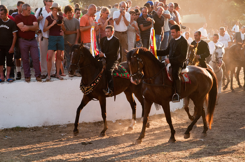 Sedilo, Italy - 06.07.2012. Ardia di San Costantino horse race. The first (left) and the third flag (right) in a moment of the event.