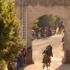 06.07.11 - Sedilo, Sardinia, Italy: Ardia Festival. The Ardia is one of the most important traditional events of Sardinia, a ritual horse race which envolve over 100 brave horsemen every year on 6 and 7 of july - (ITA) Sedilo: l'Ardia di San Costantino, sfrenata corsa a cavallo fatta in onore di San Costantino, che si svolge ogni anno a Sedilo il 6 e il 7 luglio. Nella foto, l'inizio dell'Ardia con il capocorsa (prima pandela) che passa sotto l'arco di ingresso del Santuario di San Costantino, seguito da oltre 100 altri cavalieri.