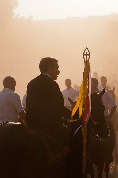 Sedilo, Italy - 06.07.2012. Ardia di San Costantino horse race. The leader, surrounded by dust, holds the first flag (Sa Prima Pandela) during a moment of the event.