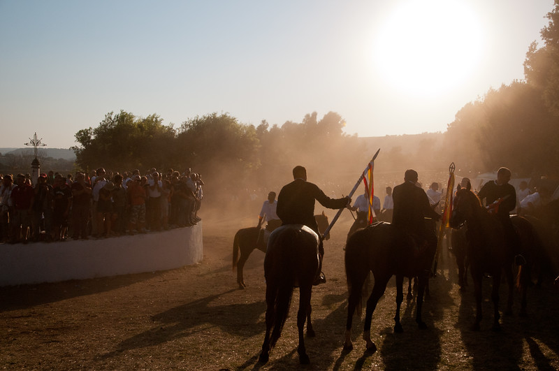 Sedilo, Italy - 06.07.2012. Ardia di San Costantino horse race. The leaders are surrounded by dust during a moment of the event.