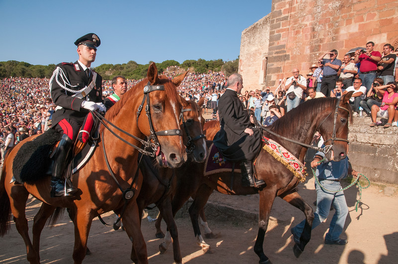 Religious and civil authorities arrive at the Sanctuary of San Costantino before the Ardia di Sedilo festival begins.