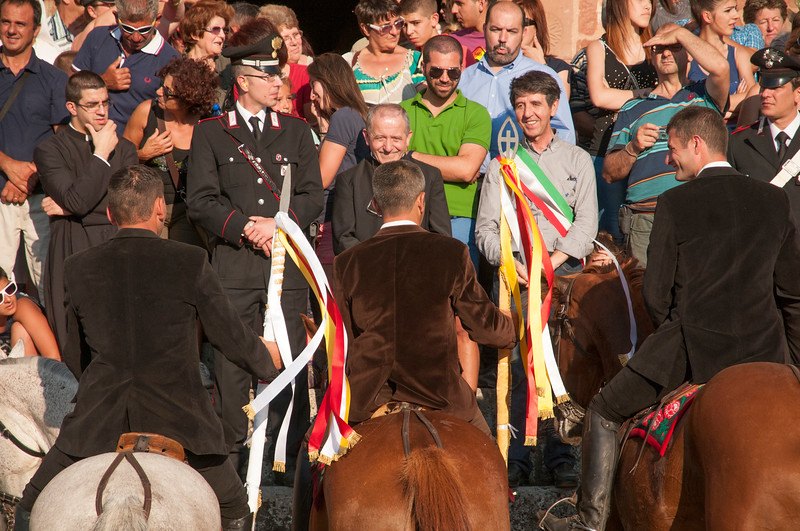 Sedilo, Italy. 06-07.2013. Ardia di San Costantino festival. The leaders of the race greets the  civil and religious authorities: the priest and the mayor of the town.