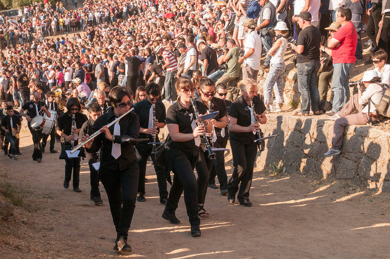 Musicians pictured playing as they march just before the beginning of the Ardia di Sedilo festival.