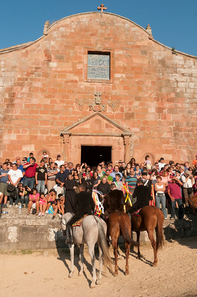 Sedilo, Italy. 06-07.2013. Ardia di San Costantino festival. Riders standing in front of the church during a moment of the event.