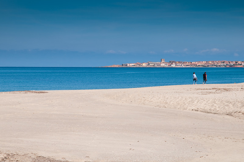 Sardinia, Italy: couple walking on Badesi beach