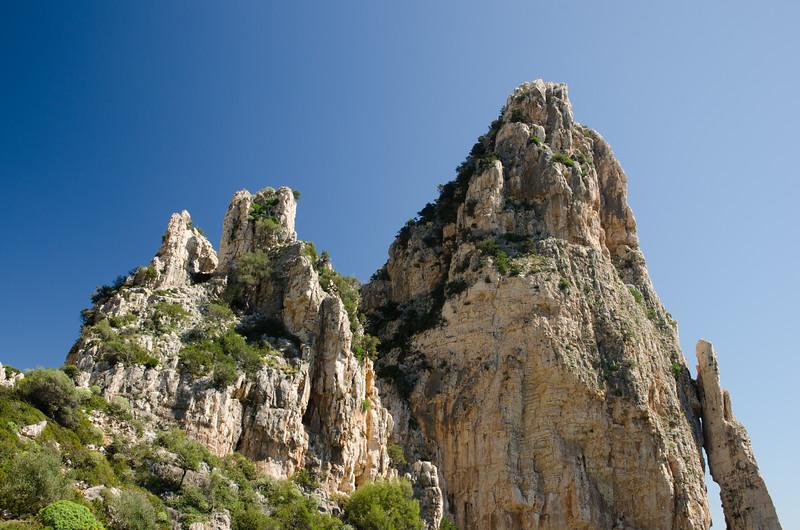 Pedra Longa rock, a cliff 128 mt above the sea, located in the Ogliastra region, on the Gulf Of Orosei, in the central-eastern coast of Sardinia.