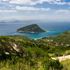 Panoramic view of Capo Figari and Figarolo island. People hiking.