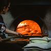 """Oliena (NU), Italy, 15.09.2013. Cortes Apertas. Preparazione del pane: """"Sa Panedda"""" di Oliena, cotta nel forno a legna."""