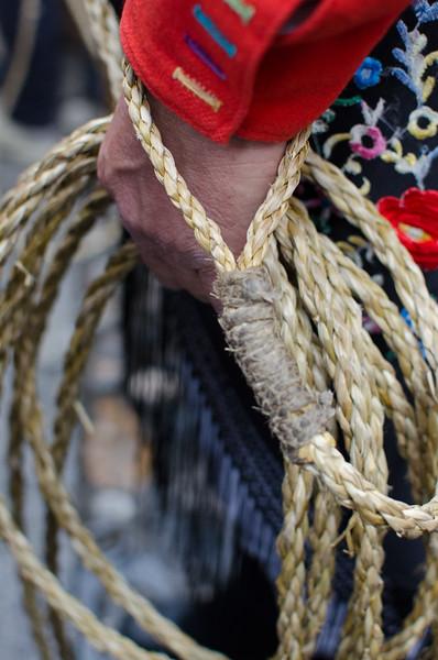 Oliena (NU), Italy, 15.09.2013. Cortes Apertas. Sfilata delle maschere tradizionali del carnavale sardo: i Mamuthones e gli issohadores di Mamoiada. Dettaglio del costume e della corda degli Issohadores.