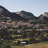 Sardinia, Italy: Aggius, view of the town with its mountains. - Sardegna, Aggius: veduta del paese con i caratteristici monti sullo sfondo