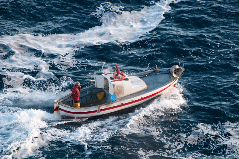 Sardinia, Italy: fisherman at Capo Figari, near Golfo Aranci - (ITA) Sardegna, barca da pesca nelle acque di Capo Figari, nei pressi di Golfo Aranci