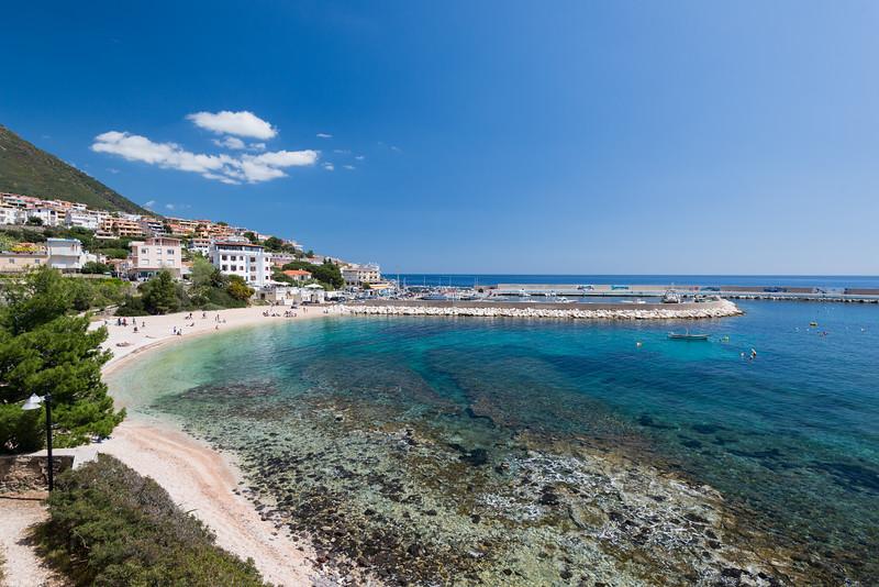 Sardinia, Cala Gonone: central beach and the touristic harbour.