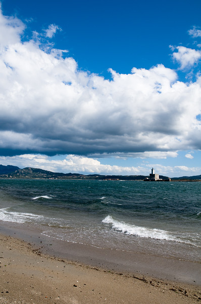 Sardinia, Italy: beach and lighthouse in the Gulf of Olbia
