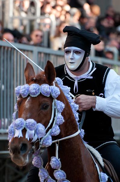 """Oristano (Italy), 21.02.2012 - Sartiglia festival (Gremio dei Falegnami), the most important carnival of Sardinia. A horseman try to pick the star during the """"Corsa alla stella"""" race."""