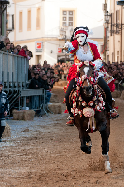 "Oristano (Italy), 21.02.2012 - Sartiglia festival (Gremio dei Falegnami), the most important carnival of Sardinia. A horsewoman try to pick the star during the ""Corsa alla stella"" race."
