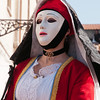 Oristano (Italy), 21.02.2012 - Sartiglia festival (Gremio dei Falegnami), the most important carnival of Sardinia. A woman wearing mask and traditional carnival dress.