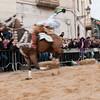 "Oristano (Italy), 21.02.2012 - Sartiglia festival (Gremio dei Falegnami), the most important carnival of Sardinia. The ""Su Componidori"", leader of the show during ""sa remada"", the final act of the ""corsa alla Stella"" race. The horseman rides supine on his horse, blessing the crowd."